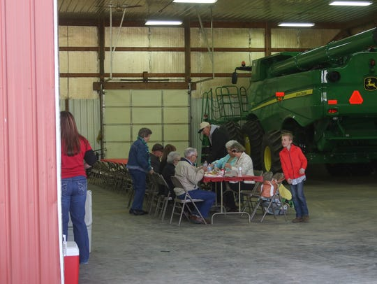 People gather at Jay Head's farm as he was presented