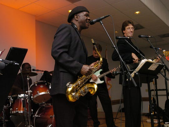 The Jazz band Tapestry entertained guests at the Civic Center Christmas Ball Friday Night.Members pictured, saxophonist Sam Williams and base guitarist Garry Singleton.
