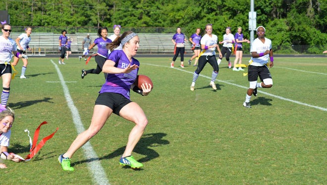 The Longest Day event this month on June 21 will shine a light on Alzheimer's with participants choosing an activity like biking, hiking, swimming or more. Shown here is the annual RivALZ Blondes vs. Brunettes flag football game raises funds for the Alzheimer's Association.
