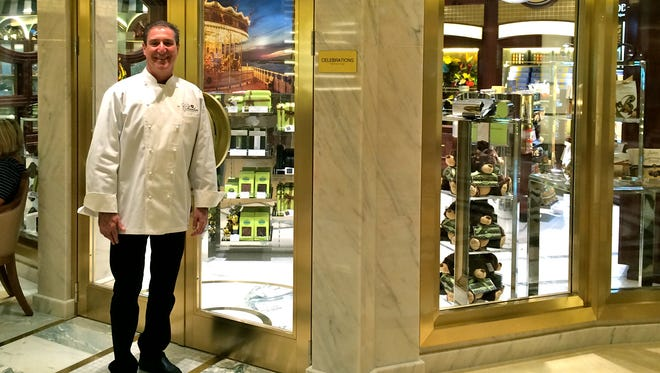 Chocolatier Norman Love outside his chocolate shop aboard the Regal Princess.