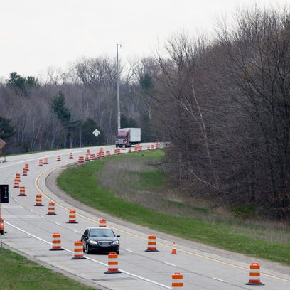 Vehicles approach the construction zone on the Taylor Road overpass Wednesday, May 4, 2016 on Interstate 69 in Kimball Township.