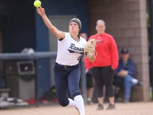 Kaitlin House, of Ramsey, fires to first base for a Robbinsville out. Sunday, June 3, 2018