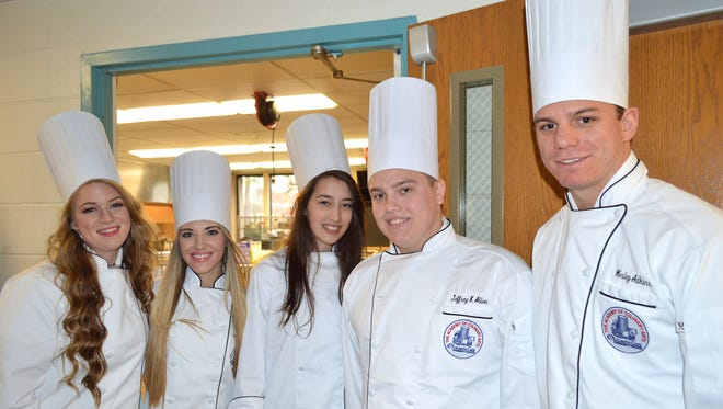 Graduates (from left) Molly Carter of Millville, Madilyn Barr of Millville, Ashly Badger of Williamstown, Jeffrey Allen of Jackson and Wesley Adkins of West Cape May line up prior to the awards ceremony for graduates of the Academy of Culinary Arts at Atlantic Cape Community College.