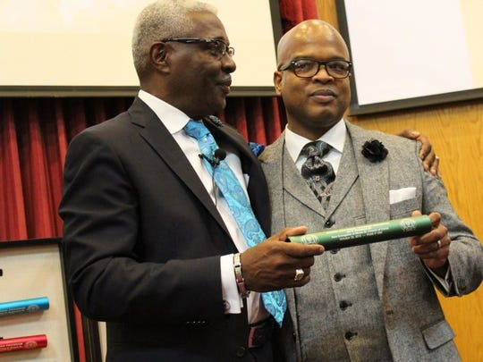 Dr. Tony Roach Sr., left, passes the baton of heritage and leadership to Ian Nickerson, who took over for Roach at Minda Street Church of Christ in October 2016.