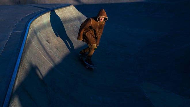 "January 1, 2018 - Bundled up in a brown winter coat, Bob Bell, 19, braves the extreme cold weather on his skateboard at Memphis Skate Park on New Year's Day. ""I try to get out to the Skate Park about every day, but I've been pretty sick lately, so I guess this is the first day in a while,"" Bell said as he honed his skills in 17 degree weather Monday afternoon. ""I'll skate in any temperature."""