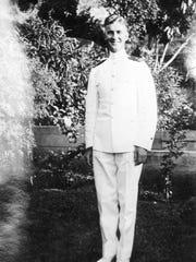 The Rev. Aloysius Schmitt is pictured in his Navy uniform