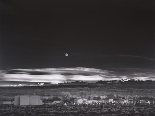 Moonrise, Hernandez, New Mexico, 1941.  Photograph