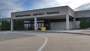 Airport officials say a hotel shuttle bus crashed into the international arrivals terminal at Mitchell International Airport on Thursday.