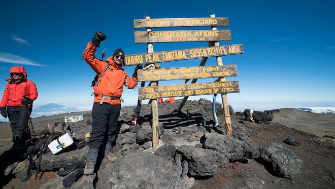 Mitchell Happeney of Over-the-Rhine makes the summit of Mount Kilimanjaro in Tanzania to honor his father's fight against the rare blood cancer multiple myeloma.
