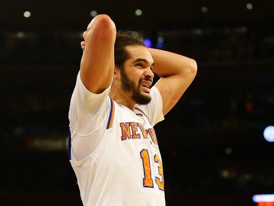 New York Knicks center Joakim Noah (13) reacts after