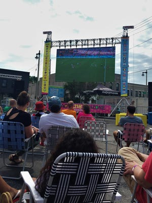 """Fans watched the game on a 16-by-9 foot jumbotron, set up in Nomad Nacional's so-called """"FanZone."""""""