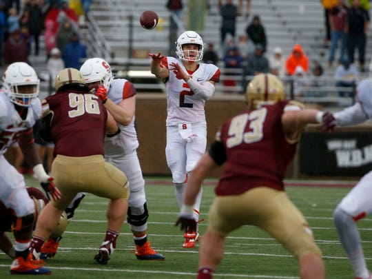 Syracuse quarterback Eric Dungey (2) passes during the first half of an NCAA college football game against Boston College, Saturday, Oct. 22, 2016, in Boston. (AP Photo/Mary Schwalm)