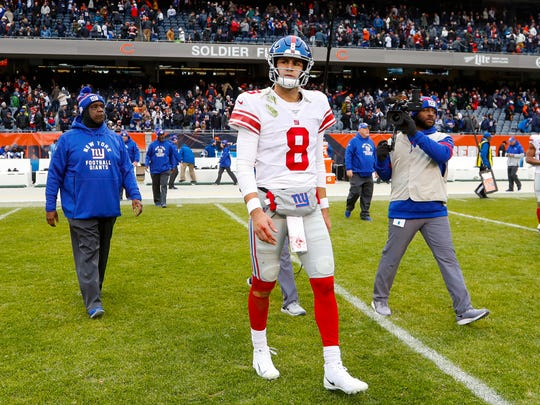 New York Giants quarterback Daniel Jones (8) walks off the field following an NFL football game against the Chicago Bears in Chicago, Sunday, Nov. 24, 2019. (AP Photo/Paul Sancya)