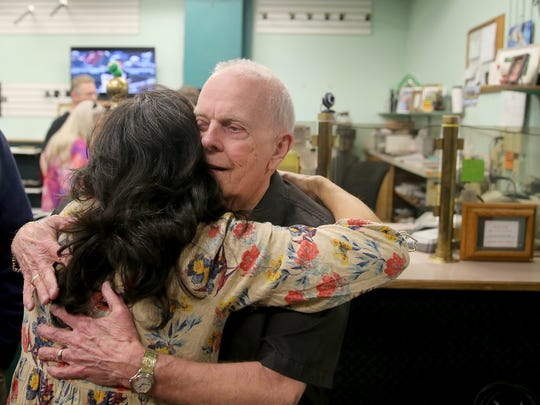 Dick Maurice, owner of Callow Pawn & Jewelry hugs longtime