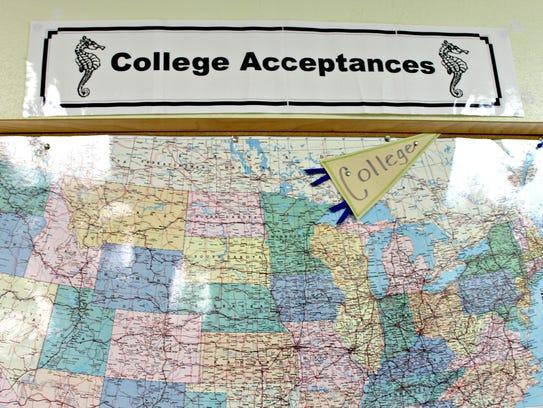 A college acceptance map hangs inside the Burlington