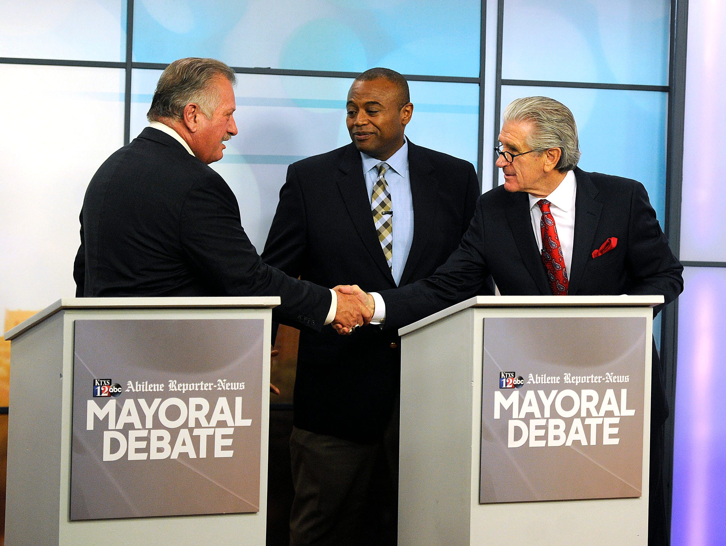 Abilene mayoral candidates, from left, Richard Kennedy, Anthony Williams and Robert Briley shake hands following the mayoral debate on April 20, sponsored by KTXS-TV and the Reporter-News.