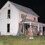Crime scene tape surrounds the Pleasant Hill Baptist Church in 2007 after a fire than was eventually ruled arson. The church reopened its doors about seven months later. Investigators are still looking into the case.