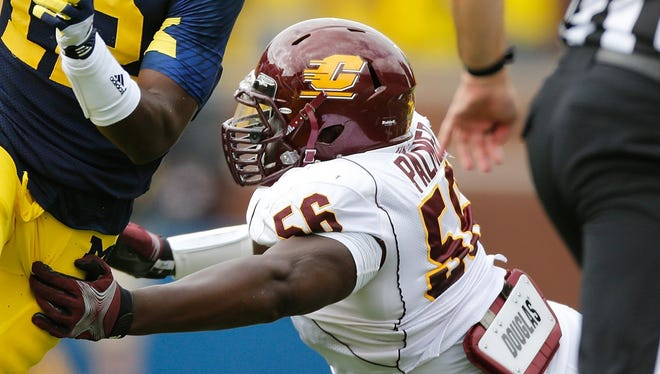 Devin Gardner of the Michigan Wolverines runs past Louis Palmer, right, of the Central Michigan Chippewas on Aug. 31, 2013, in Ann Arbor.