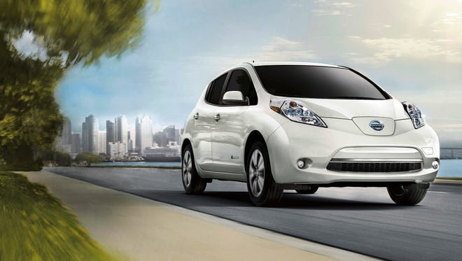 This photo provided by Nissan shows the 2017 Leaf EV which is scheduled to be replaced by an all-new model in fall 2017. Edmunds predicts that Nissan dealers will offer heavy discounts on the current model in order to clear the way for the redesigned version which will likely offer more range and additional features. (Courtesy of Nissan North America, Inc. via AP)