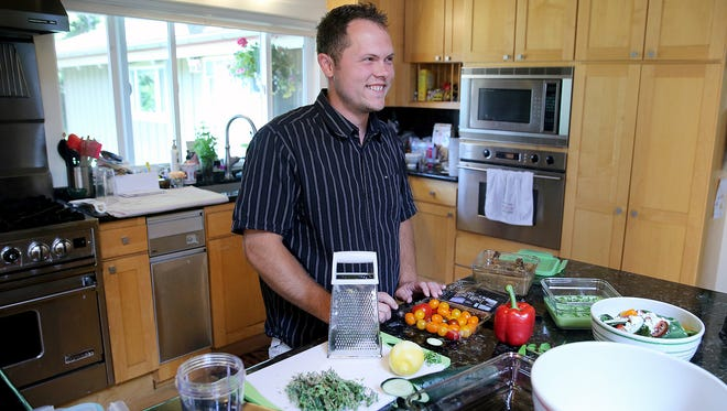 Chef Ben Cox prepares a variety of dishes in his home kitchen on Bainbridge Island. Cox is the co-founder of Mira Bainbridge, a new local meal-delivery service.
