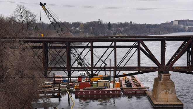 A construction barge is positioned Wednesday, April 6, in the Mississippi River north of Veterans Bridge. The barge is used in the construction of the Beaver Islands Trail extension project.