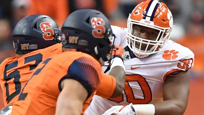 Clemson defensive lineman Dexter Lawrence (90) is blocked by Syracuse offensive lineman Evan Adams (63) during the 1st quarter on Friday, Oct. 13, 2017 at the Carrier Dome in Syracuse, N.Y.