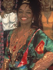 """Artist Faith Ringgold stands in front of her work """"The"""