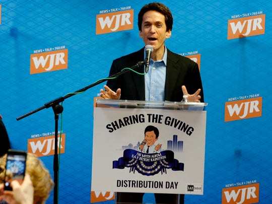 Mitch Albom talks during the S.A.Y. Detroit radiothon fund distribution event at the Fisher Building in Detroit on Tuesday, March 27, 2018.