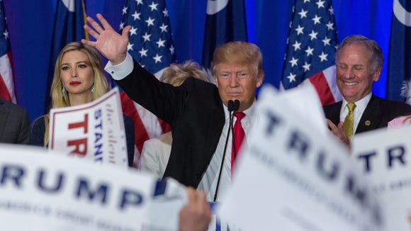 Trump acknowledges cheering supporters celebrating