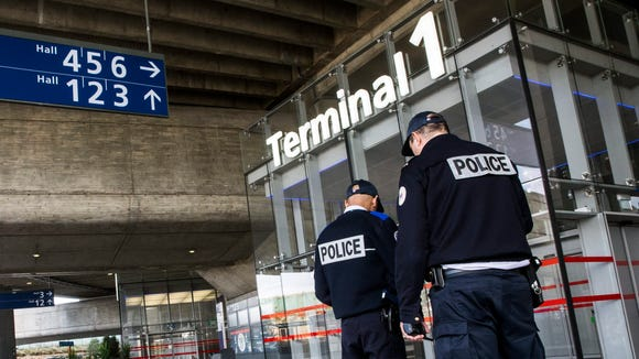 French Police patrol Terminal 1 at the Charles de Gaulle