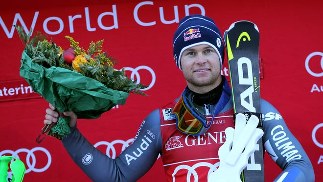 France's Alexis Pinturault celebrates on the podium after winning the Men's Combined FIS Alpine World Cup in Santa Caterina on Dec. 29, 2016.