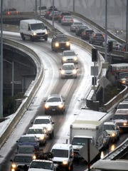 Traffic along the Interstate 5 and Interstate 84 interchange ramps are jammed after a snow storm moved in on the area in Portland on Wednesday.