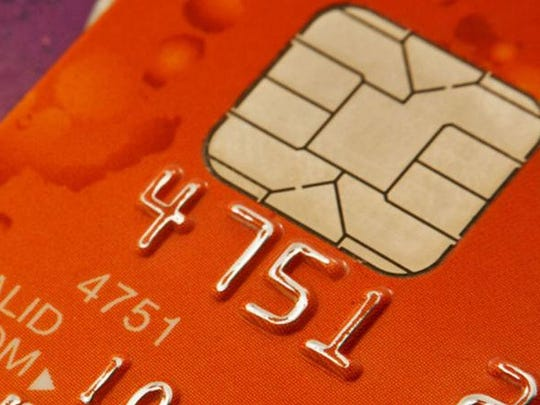 "A ""smart"" credit card's chip is shown."