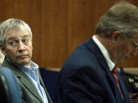 (File photo) Millionaire murder defendant Robert Durst (C) sits in State District Judge Susan Criss court with his attorney Dick DeGuerin (R) November 10, 2003 at the Galveston County Courthouse in Galveston, Texas. Durst is being charged for the murder and mutilation of his neighbor Morris Black.