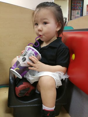 Jenevieve Iriarte, 1, enjoys some juice at Chuck E. Cheese's in Tamuning. When dining out with young children, opt for a booth for more comfort, and keep them occupied with toys and treats. Eating out with kids doesn't need to be limited to kids restaurants, but look for a family-friendly environment.