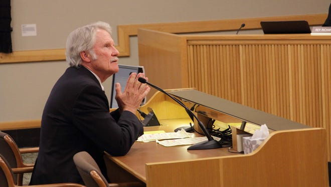 Gov. John Kitzhaber speaks to a state legislative committee in Salem, Ore., on Thursday, May 29, 2014. Kitzhaber is seeking a lawsuit against Oracle Corp. over Oregon's online health insurance enrollment system, the failure of which embarrassed the state and resulted in multiple investigations. (AP Photo/Chad Garland)