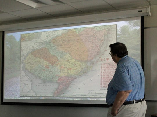 Paul W. Schopp, assistant director of the South Jersey Culture and History Center of Stockton University, displays a map of South Jersey railroads during the Oct. 11 lecture.