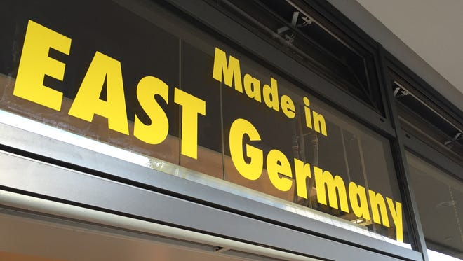 A a sign for a shop in Berlin that sells goods available during the Cold War in East Germany.