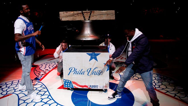 Rapper Meek Mill, left, comes out to ring a Liberty Bell replica with actor Kevin Hart, right, before Game 5 of the 76ers-Heat NBA playoff series.