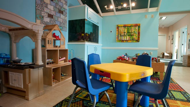The lobby area of the Gulf Coast Kid's House is a warm kid-friendly environment.