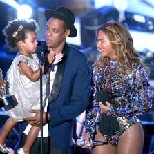 Blue Ivy Carter, Jay Z and Beyonce onstage during the 2014 MTV Video Music Awards at The Forum on August 24, 2014 in Inglewood, California.