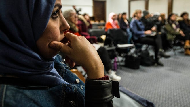 Immigrants, most of whom either have green cards or have become US citizens, attend a Q&A Tuesday night, Feb. 21, 2017, in Burlington hosted by volunteer lawyers and others familiar with immigration law to answer questions and hear concerns about President Donald Trump's recent executive order. Although stalled by the courts, many expressed concern about leaving the country to visit family for fear of not being allowed back in because of their religion or where they came from.