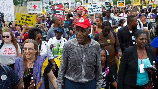 """""""Lethal Weapon"""" star and activist Danny Glover joins the Poor People's Campaign rally march, held June 23 on the National Mall in Washington."""