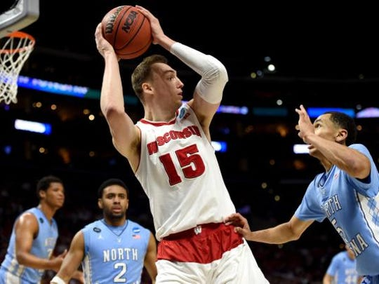 Sam Dekker (15) of the Wisconsin Badgers with the ball against Marcus Paige (5) of the North Carolina Tar Heels in the second half during the West Regional Semifinal of the 2015 NCAA Men's Basketball Tournament at Staples Center on March 26, 2015 in Los Angeles, California.