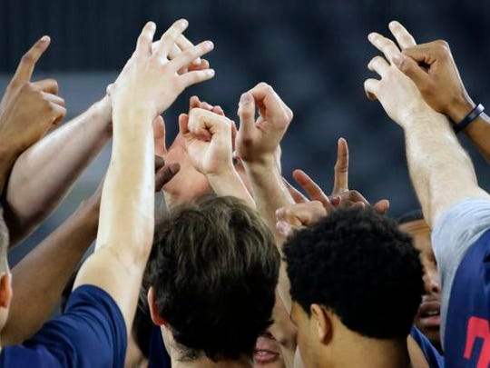 Gonzaga players huddle during a practice session for a college basketball regional semifinal game in the NCAA Tournament Thursday, March 26, 2015, in Houston. Gonzaga plays UCLA on Friday.