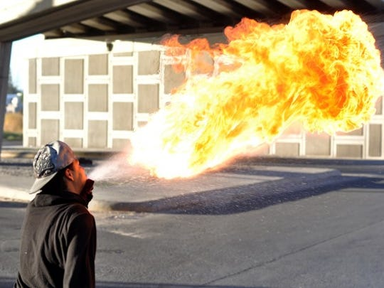 Firebreather Alfredo Humberto Velásquez can be seen performing at street corners in Juárez.