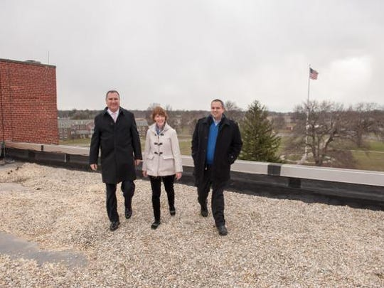 TetherView, a turnkey private cloud provider, recently started operating out of the old Russel Hall building at the closed Fort Monmouth in Oceanport, NJ. Pictured on the roof overlooking much of the grounds  are from left:  Peter Calistri, Chief Operating Officer,  Mary Donnelly, Director of Marketing, and  Michael Abboud, CEO. Photo was taken on Tuesday, January 12, 2016.
