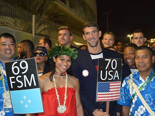 636061287180446508-Opening-Ceremony-FSM-USA-Flag-Bearers.jpg
