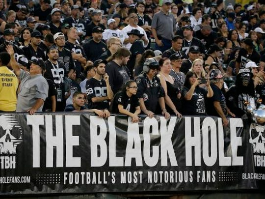 Oakland Raiders fans watch from the Black Hole section of Oakland Alameda County Coliseum during the first half of an NFL preseason football game between the Raiders and the Seattle Seahawks in Oakland, Calif., Thursday, Aug. 31, 2017. (AP Photo/Eric Risberg)