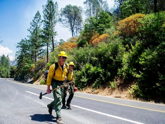 Kern County firefighters make their way to the Redbud